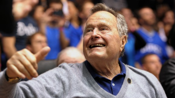 DURHAM, NC - JANUARY 18: Former U.S. President George H.W. Bush waves to fans during a game between the North Carolina State Wolfpack and the Duke Blue Devils at Cameron Indoor Stadium on January 18, 2014 in Durham, North Carolina. (Photo by Lance King/Getty Images)