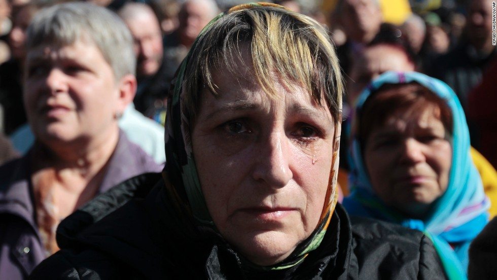 A woman cries Sunday, March 30, during a gathering to honor those who were killed during protests in Kiev's Independence Square.