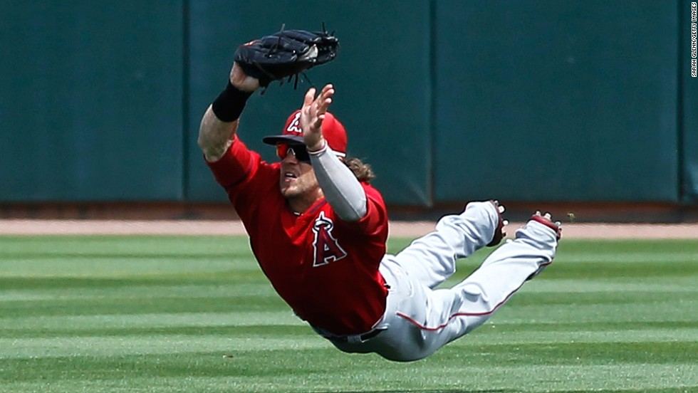 Collin Cowgill of the Los Angeles Angels makes a diving catch during a spring training game Wednesday, March 26, in Phoenix.