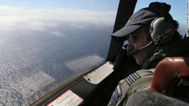 "Royal New Zealand Air Force P3 Orion captain Wing Commander Rob Shearer looks out of the window of his aircraft while searching for missing Malaysia Airlines flight MH370, over the Indian Ocean on March 31, 2014.  No time limit will be imposed on the search for MH370 because the world deserves to know what happened, Australian Prime MinisterTony Abbott said, as a ship equipped to locate the plane's ""black box"" prepared to set sail.    AFP PHOTO / POOL / Rob GRIFFITH        (Photo credit should read ROB GRIFFITH/AFP/Getty Images)"