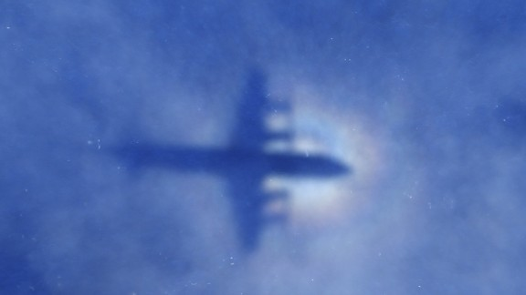 This shadow of a Royal New Zealand Air Force P3 Orion aircraft is seen on low cloud cover while it searches for missing Malaysia Airlines flight MH370, over the Indian Ocean on March 31, 2014. No time limit will be imposed on the search for MH370 because the world deserves to know what happened, Australian Prime MinisterTony Abbott said, as a ship equipped to locate the plane