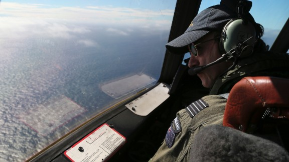 Royal New Zealand Air Force P-3 Orion's captain, Wing Comdr. Rob Shearer watches out of the window of his aircraft while searching for the missing Malaysia Airlines Flight MH370 in the southern Indian Ocean, Monday, March 31, 2014. (AP Photo/Rob Griffith/Pool/AP)