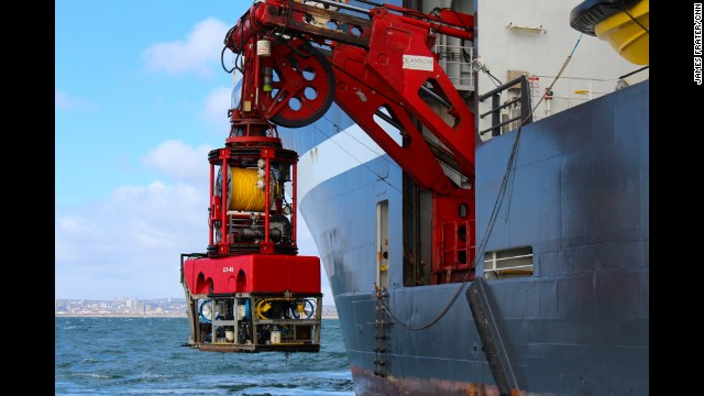 A remotely operated vehicle is lowered into the waters of the North Sea on March 23.