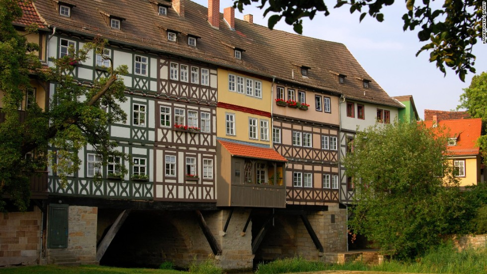 "Krämerbrücke -- ""Merchant's Bridge"" --located in Erfurt, Germany, is a stone arch bridge dating back to 1325. The ground floors of most houses have been converted to antique and craft shops while the upper floors are still used as private residences."
