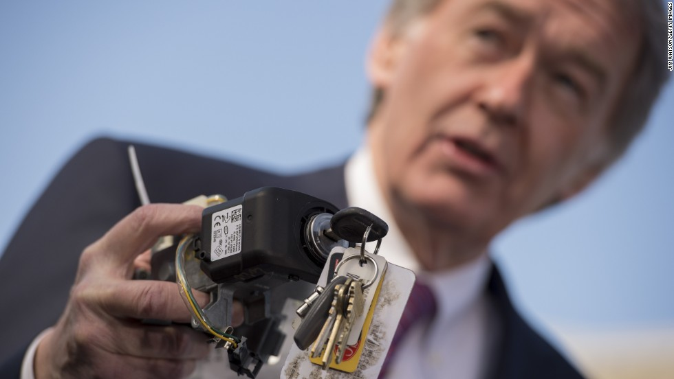 U.S. Sen. Edward Markey, D-Massachusetts, holds up a faulty GM ignition switch during the news conference, which was held in Washington before Barra spoke to the House subcommittee.