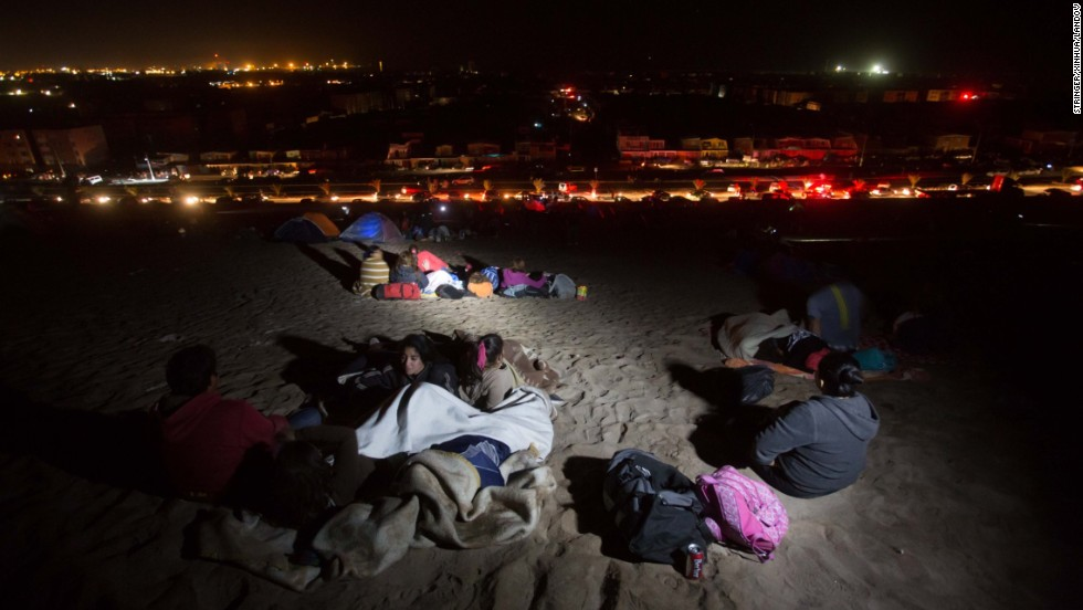 People stay on a beach in Arica, Chile, after the earthquake struck. The quake generated tsunami waves of more than 6 feet on the coast of Pisagua, according to the Pacific Tsunami Watch Center. Iquique saw 7-foot waves.
