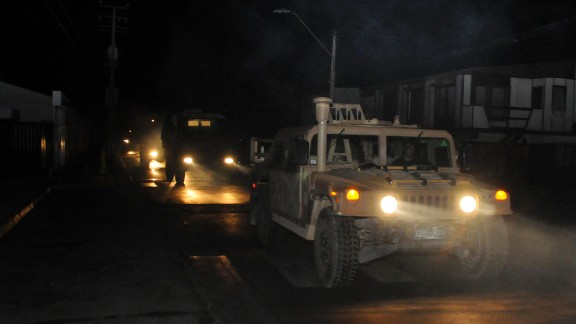 """A military vehicle patrols the streets of Iquique on April 1. Chile is on the """"Ring of Fire,"""" an arc of volcanoes and fault lines that circles the Pacific Basin and is prone to frequent earthquakes and volcanic eruptions."""