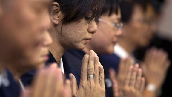 Volunteers from Taiwan's Buddhist association offer prayers for the Chinese passengers aboard the missing Malaysia Airlines flight MH370, at a hotel in Beijing, China Tuesday, April 1, 2014. Although it has been slow, difficult and frustrating so far, the search for the missing Malaysia Airlines jet is nowhere near the point of being scaled back, Australia's Prime Minister Tony Abbott said. The three-week hunt for Flight 370 has turned up no sign of the Boeing 777, which vanished March 8 with 239 people bound for Beijing from Kuala Lumpur. (AP Photo/Andy Wong)