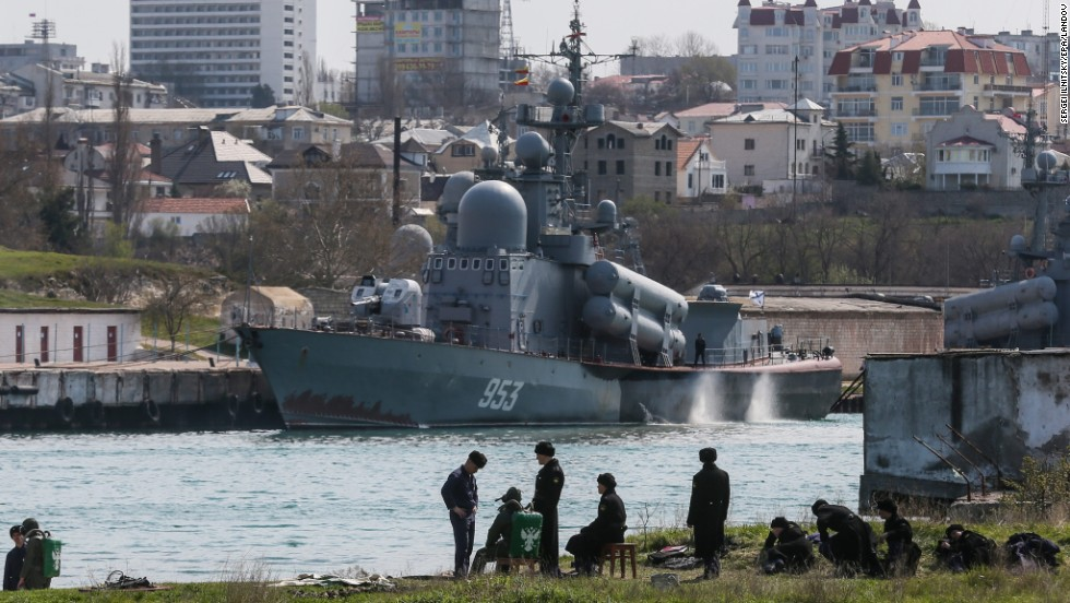 Russian soldiers prepare for diving training in front of a Tarantul-III class missile boat Tuesday, April 1, in Sevastopol.