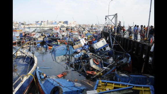 Fishing boats washed ashore by a tsunami sit in the waters of Iquique on April 2.
