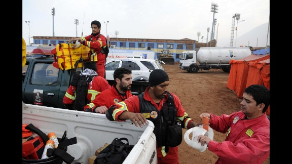 Rescue personnel get ready to go into action April 2 in Iquique.  More than 2,500 homes sustained serious structural damage in the region around the northern port city, an official said.