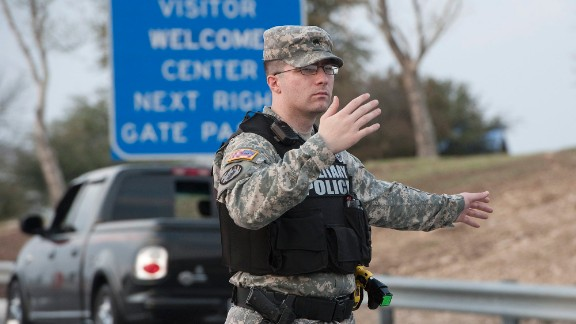 Military police direct traffic outside Fort Hood.