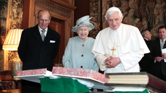 The Queen, accompanied by her husband, Prince Philip, exchanges gifts with Pope Benedict XVI in Edinburgh, Scotland, in September 2010.