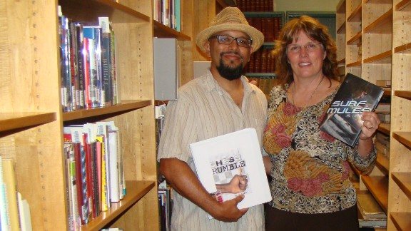 """""""I would like to see more cinema representation of the really good books done in a huge fashion,"""" said Joan Kaywell, who maintains the Hipple Collection of Young Adult Literature at the University of South Florida.  She is pictured here with author Greg Neri at the Hipple Collection."""