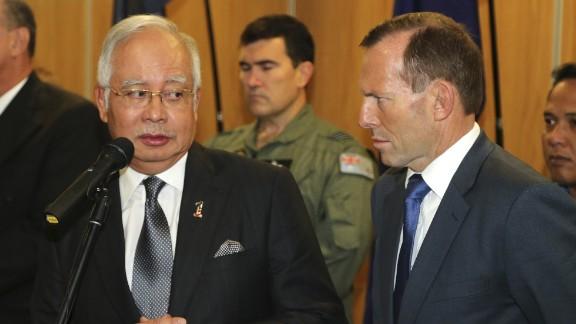 Malaysia Prime Minister Najib Razak (L) looks at Australian Prime Minister Tony Abbott at RAAF base Pearce on April 3, 2014 in Perth, Australia.