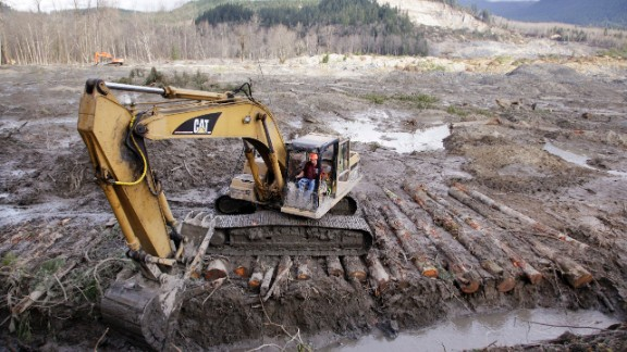 An excavator clears a drainage channel on Wednesday, April 2.