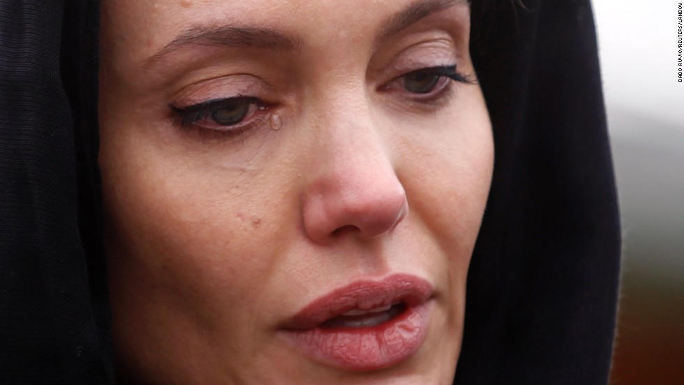 Actress Angelina Jolie reacts at the Srebrenica Genocide Memorial after laying a wreath there Friday, March 28, in Potocari, Bosnia-Herzegovina. Over a period of five days in July 1995, about 8,000 Muslim men and boys were killed in the town of Srebrenica by the Bosnian Serb army.