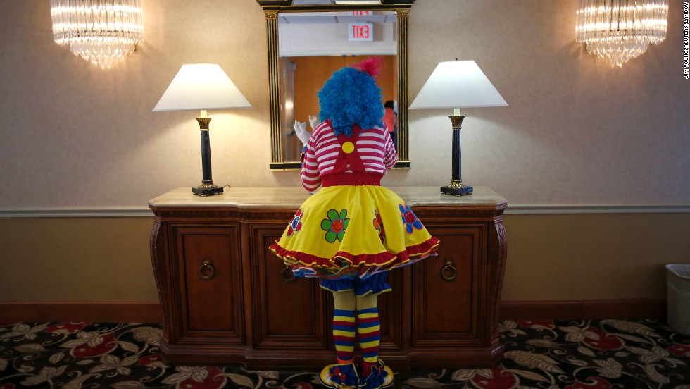 A clown checks her makeup in a hotel hallway on Wednesday, March 26, before competing at the World Clown Association's annual convention in Northbrook, Illinois.