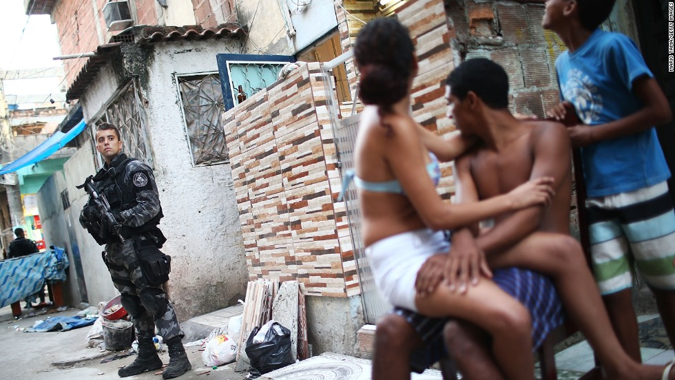 A military police officer stands guard at Complexo da Mare, one of the largest favela complexes in Rio de Janeiro, on Sunday, March 30. The Brazilian government has deployed federal forces to violence-plagued slums ahead of the FIFA World Cup, which starts in June.