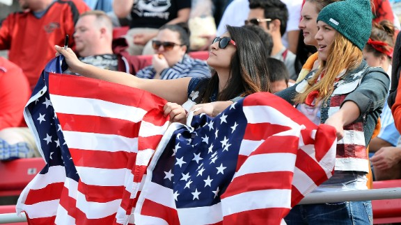 Two fans cheer on the American team during the recent Las Vegas leg of the HSBC Sevens World Series.