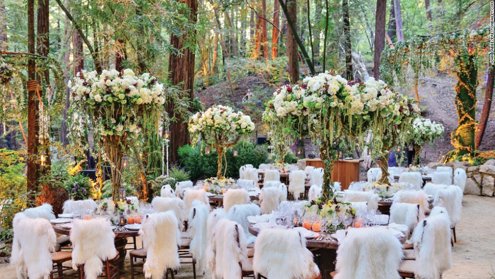 Strands of flowers, wrapped and flowing, met with elaborate table arrangements to create a signature Preston Bailey environment for wedding guests.
