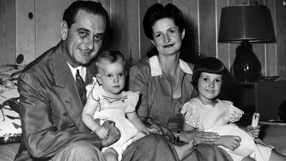 Lyndon B. Johnson poses for a family portrait with his wife Lady Bird and daughters on August 25, 1948. He holds Luci Baines on his lap and his wife holds Lynda Bird, who was 4 years old.
