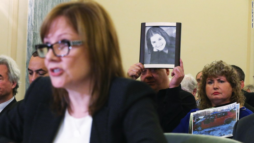 The parents of Kelly Erin Ruddy hold up pictures of their daughter and her car Wednesday, April 2, while General Motors CEO Mary Barra testifies in Washington on the faulty ignition switch that has been linked to 13 deaths. Ruddy was killed in 2010 when she lost control of her 2005 Chevrolet Cobalt.
