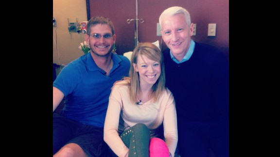 CNN's Anderson Cooper with Adrianne Haslet-Davis and her husband Adam Davis a week after the bombings.