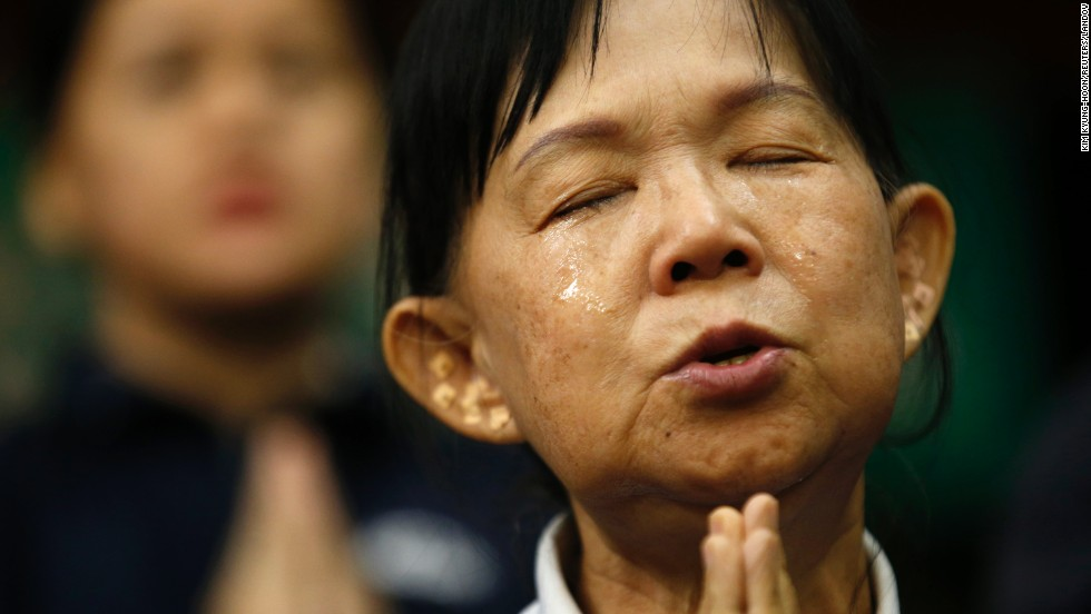 A Taiwanese volunteer cries as she prays for the passengers of Malaysia Airlines Flight 370 on Tuesday, April 1, in Beijing.