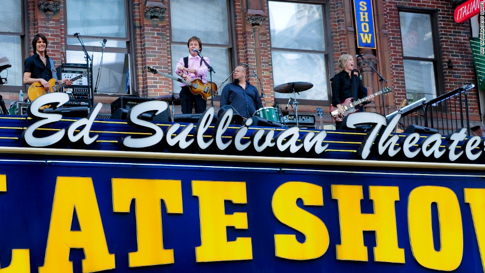"Musician Paul McCartney took over the marquee of the Ed Sullivan Theater, where the Beatles made big news in 1964, to performs for the '""Late Show"" on July 15, 2009."