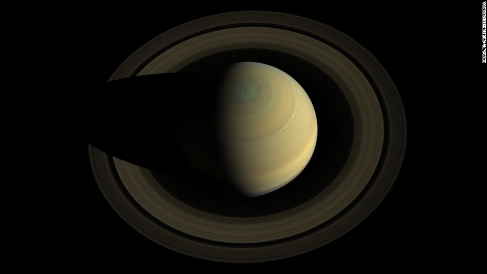 Cassini glided high above Saturn in October 2013 to capture this 36-image mosaic of the ringed planet. The colors of the planet appear natural, just as the human eye would see them.