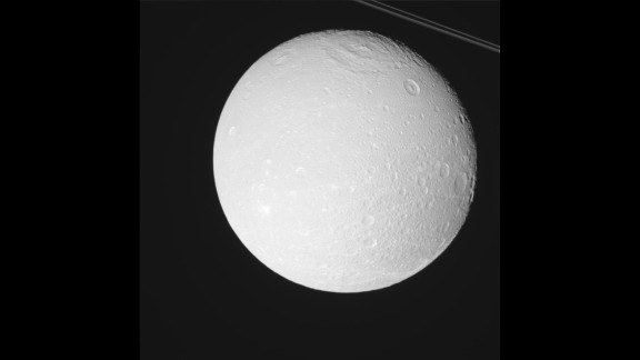 Saturn has a small moon called Dione orbiting about 234,000 miles away. That