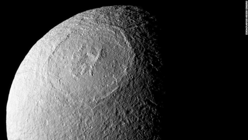 The Odysseus Crater spans 280 miles across the northern hemisphere of Tethys.