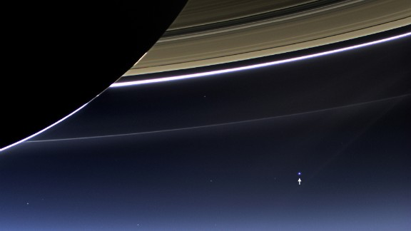The small bright dot seen in the bottom right is not another Saturn moon. It