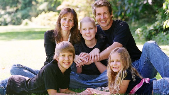 "When leukemia patient Christian Barker, center, received a bone marrow transplant, the donor cells attacked his body. By the time he was given permission to use an experimental drug, it was too late, his mother says. Christian died at age 14. ""What haunts me is how my child suffered so much,"" says Sandy Barker."