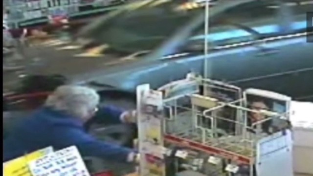 car crashes into cvs  nearly hits woman