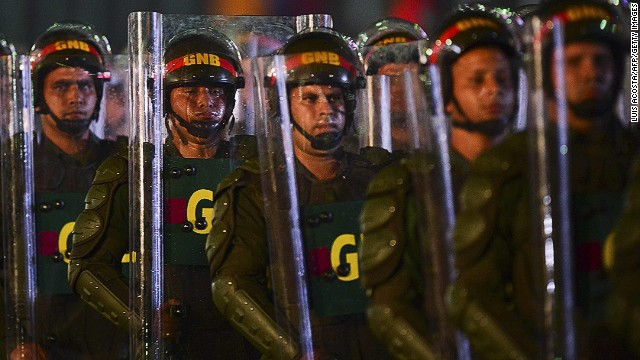 National Guard soldiers in riot gear after the installation of President Nicolas Maduro in Caracas on March 19, 2013.