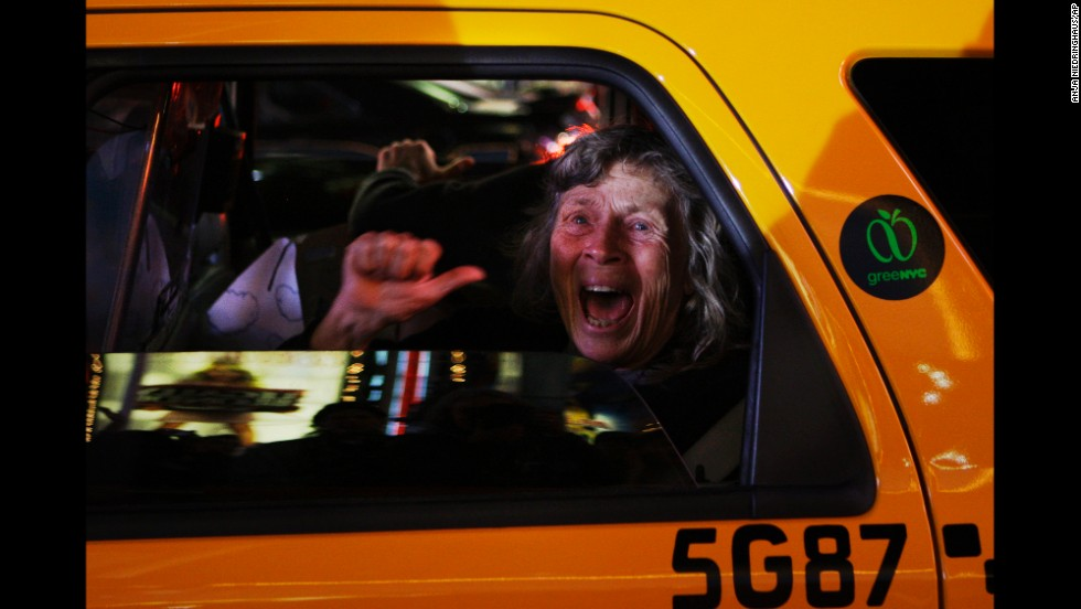 A woman reacts in a New York taxi as television networks call the 2008 presidential race for Barack Obama.
