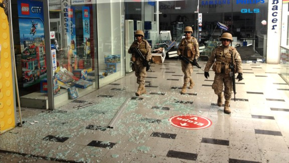 Soldiers patrol inside a mall in Iquique on April 3.