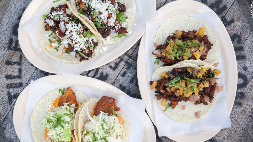 Whether they're filled with al pastor, Peking duck, or a bone-in pork chop, America's best tacos aren't just for Tuesday. Here are 10 of the best.