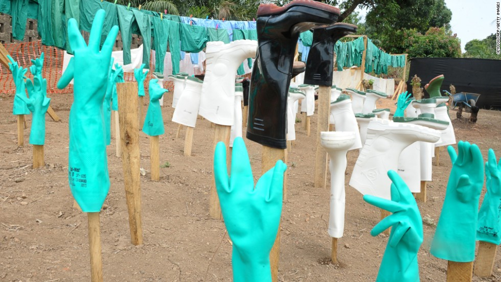 Gloves and boots used by medical staff, drying in the sun, at a center for victims of the Ebola virus in Gueckedou, Guinea.