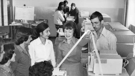 Male and female Afghan students studying computing technology sit together and listen to a female Soviet teacher (center) in the Computing Center of the Polytechnical Institute in Kabul in 1981. The Soviet Union had invaded the country in December 1979.