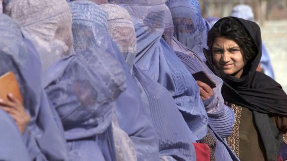 "Women wait to receive food aid during a U.N. World Food Program scheme in Kabul in December 2001. ""Even inside Afghanistan, female dress code varies hugely between regions,"" says Mosadiq. ""You"