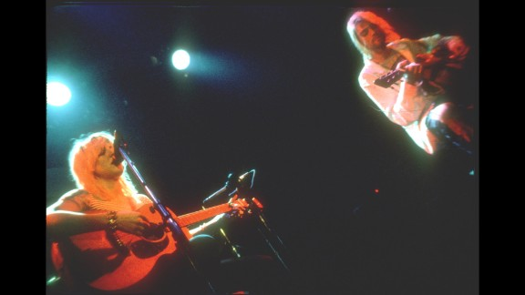 Cobain performs on stage with Love and her band Hole circa 1990.