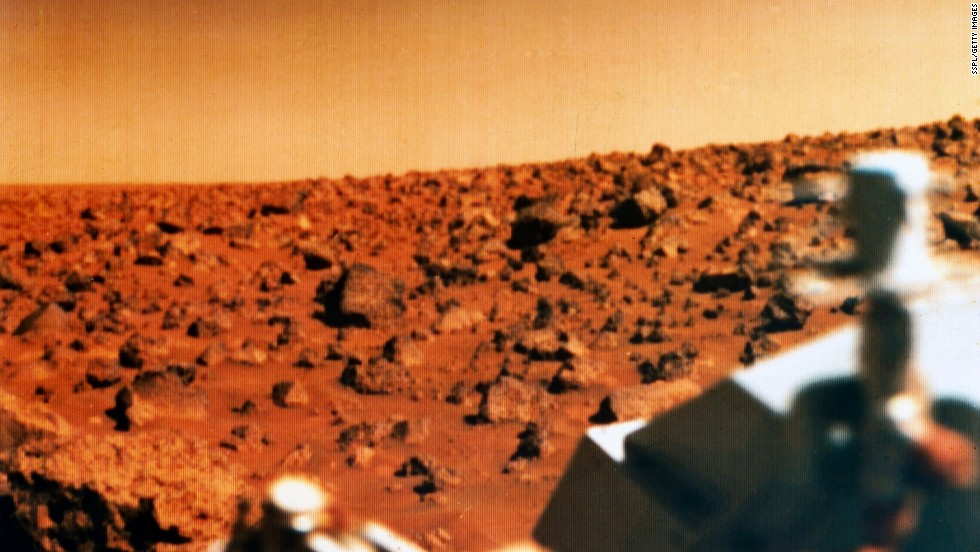 Don't we all wonder what's out there, especially when we launch spacecraft to another planet? Perhaps our greatest search is for whether we live alone in the cosmos. This photo shows the red Martian landscape and part of the Viking 2 lander, which was launched in September 1975 and landed in the Utopia Planitia region of Mars on September 3, 1976. It studied the Martian environment, soil constituents and searched for simple life forms. None were found.