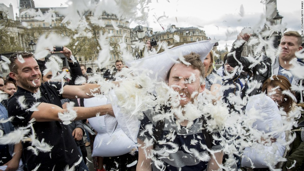 Revelers take part in a giant pillow fight on the north terrace of London's Trafalgar Square.