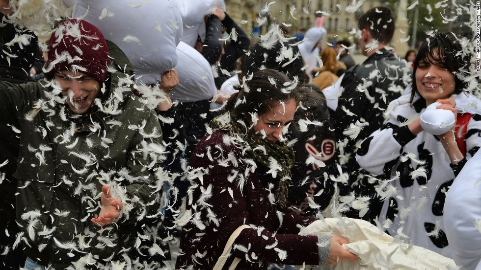 Pillows and feathers take flight as the fight takes place in Bucharest, Romania.