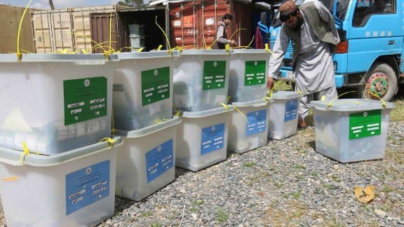 Workers of the Independent Election Commission transfer ballot boxes to an Election Commission office in Kandahar, Afghanistan, on April 6.