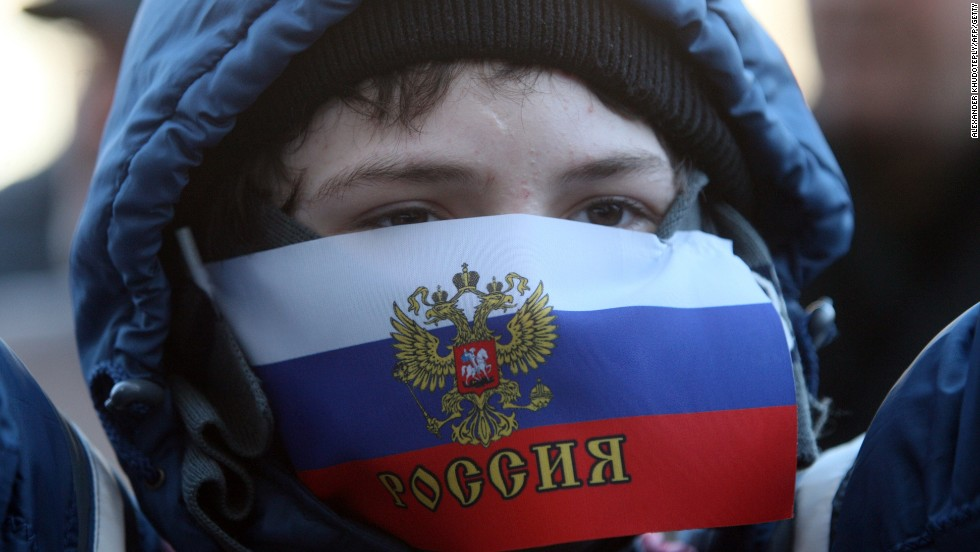 A young demonstrator with his mouth covered by a Russian flag attends a pro-Russia rally outside the regional government administration building in Donetsk on Saturday, April 5.
