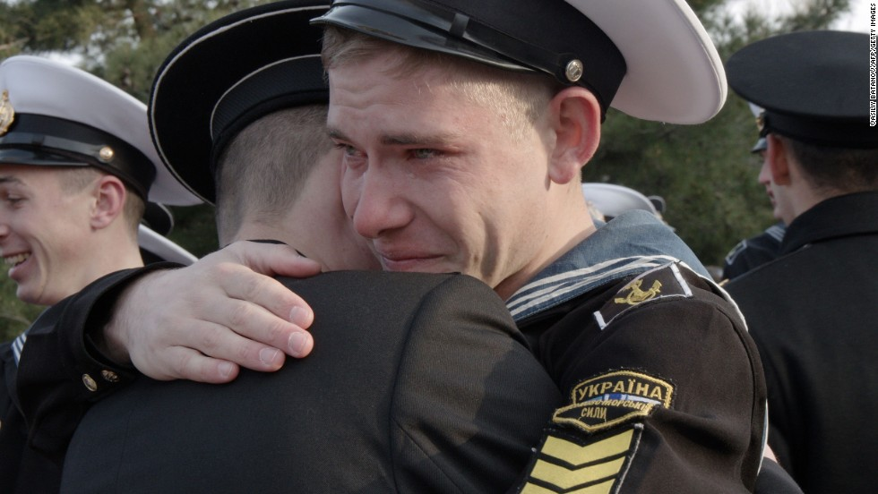 Ukrainian cadets at the Higher Naval School embrace a friend who has decided to stay in the school during a departure ceremony in Sevastopol, Crimea, on Friday, April 4. Some 120 cadets who refused to take Russian citizenship left the school to return to Ukraine.